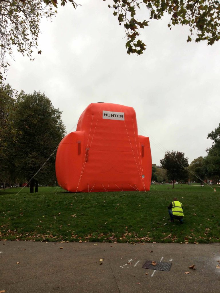 Giant red inflatable backpack with man in hi vis