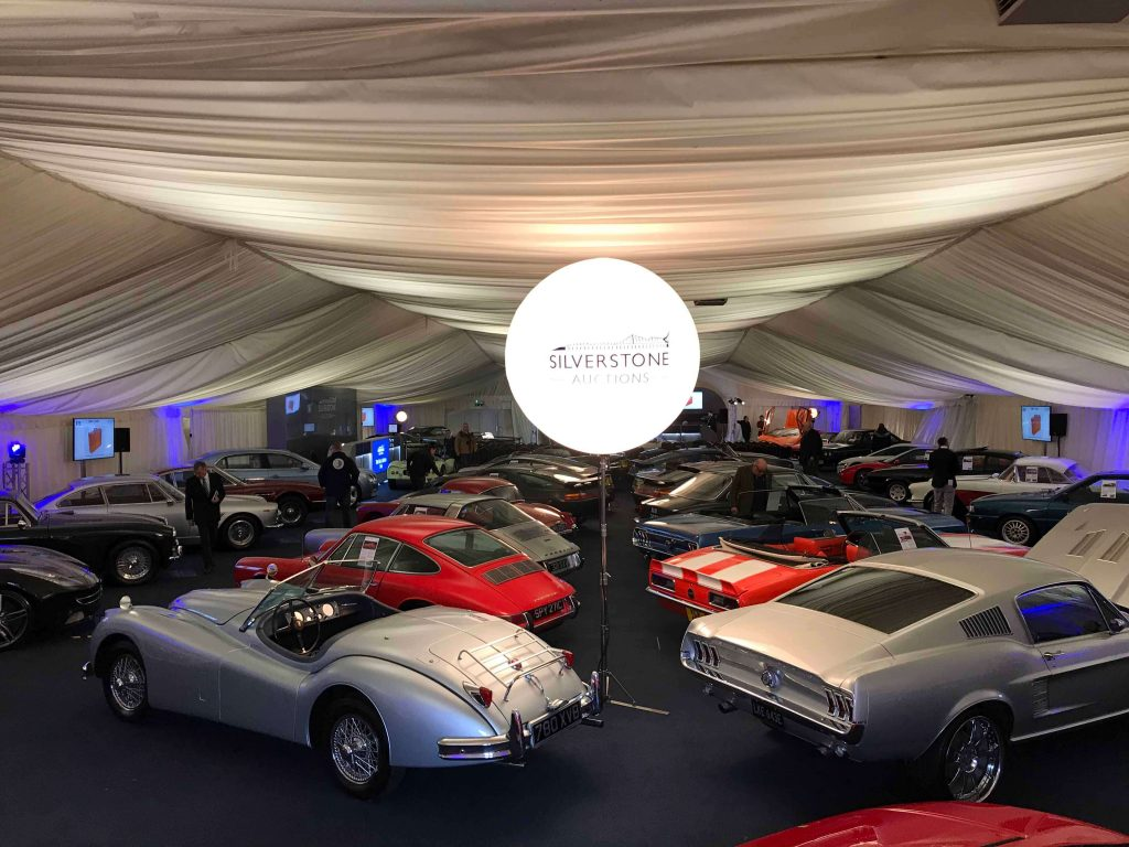 marquee with classic cars and balloon light