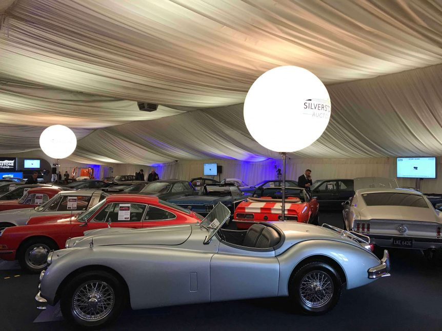 classic cars and balloon lights