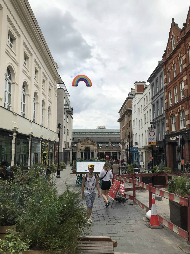 view of giant inflatable down James Street to Covent Garden