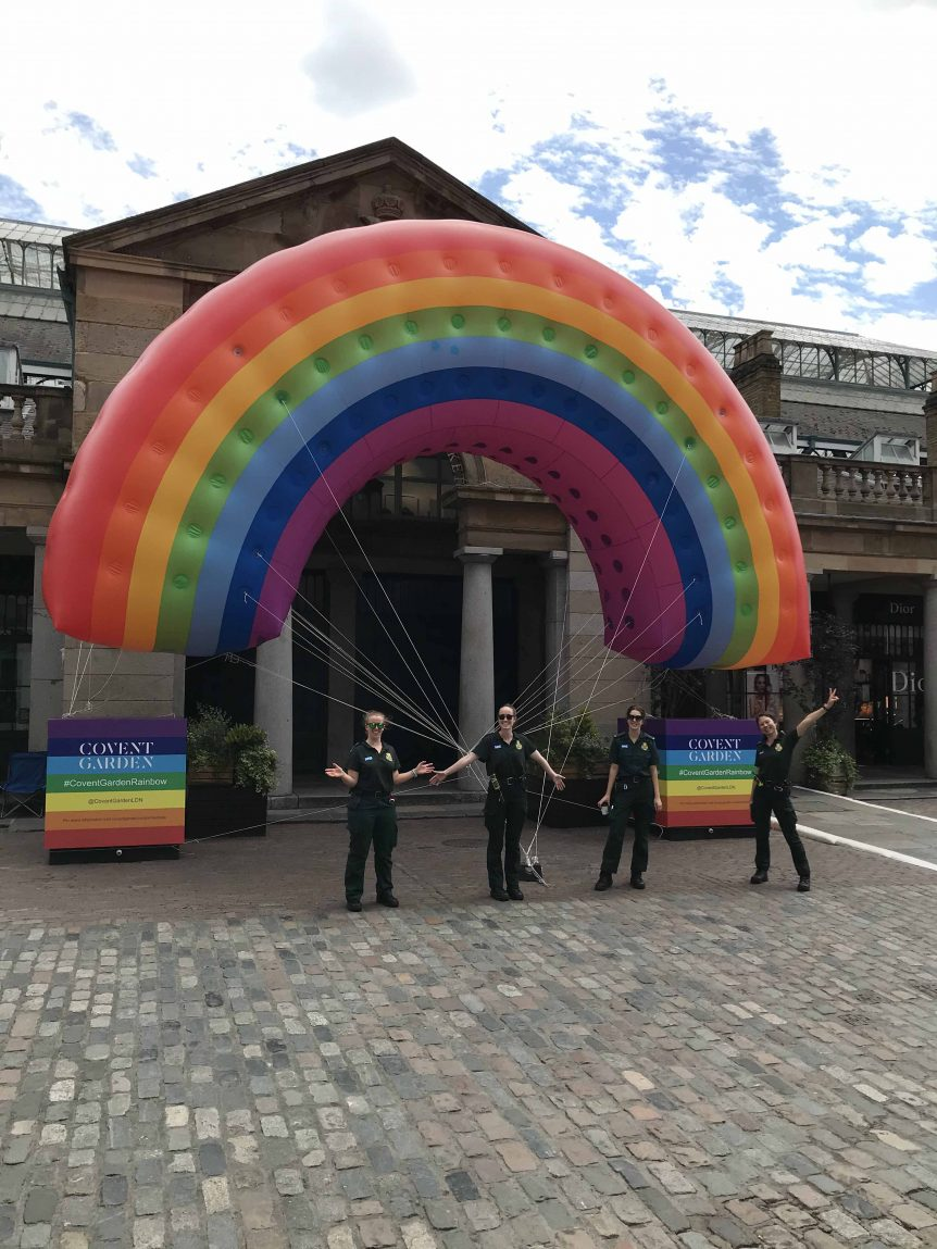 NHS staff with giant inflatable rainbow at Covent Garden